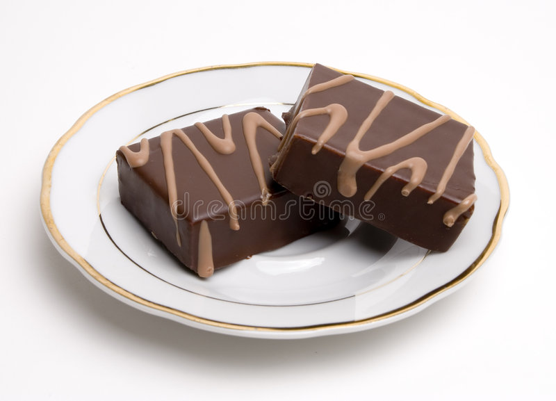 Chocolate squares on a saucer royalty free stock photos