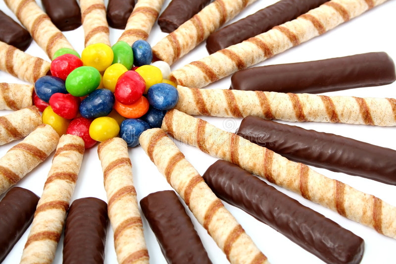 Chocolate sticks with a cream and the multi-coloured sweets isol royalty free stock photography