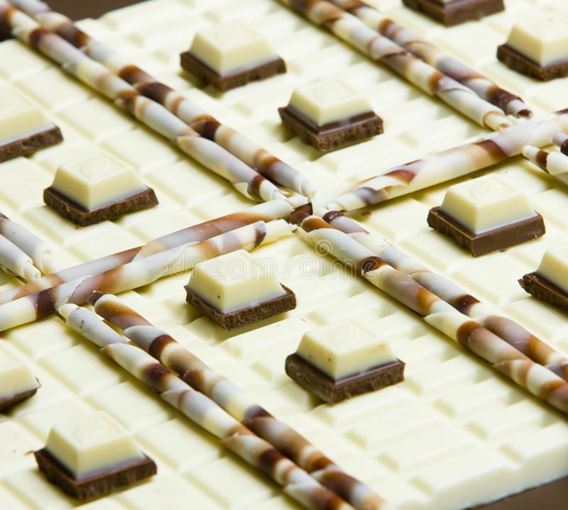 Chocolate still life. Inside, indoor, indoors, interior, interiors, food, foodstuff, aliment, aliments, nutritive, nutrition, nourishment, chocolates, white stock image