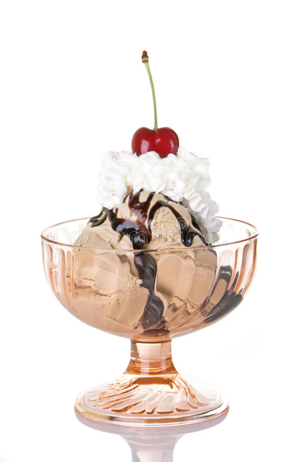 Chocolate Sundae. Chocolate ice cream sundae with whipped cream and fresh bing cherry stock images