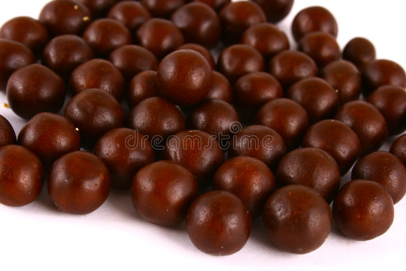 Chocolate sweets against white