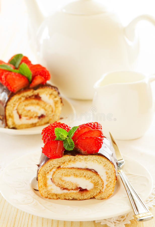 Chocolate swiss roll cake. With strawberries royalty free stock image
