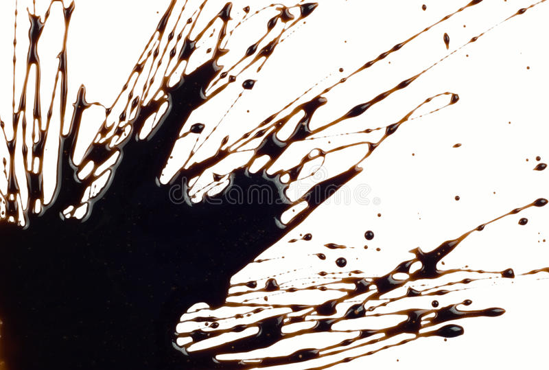 Chocolate syrup. Leaking on white background stock photo