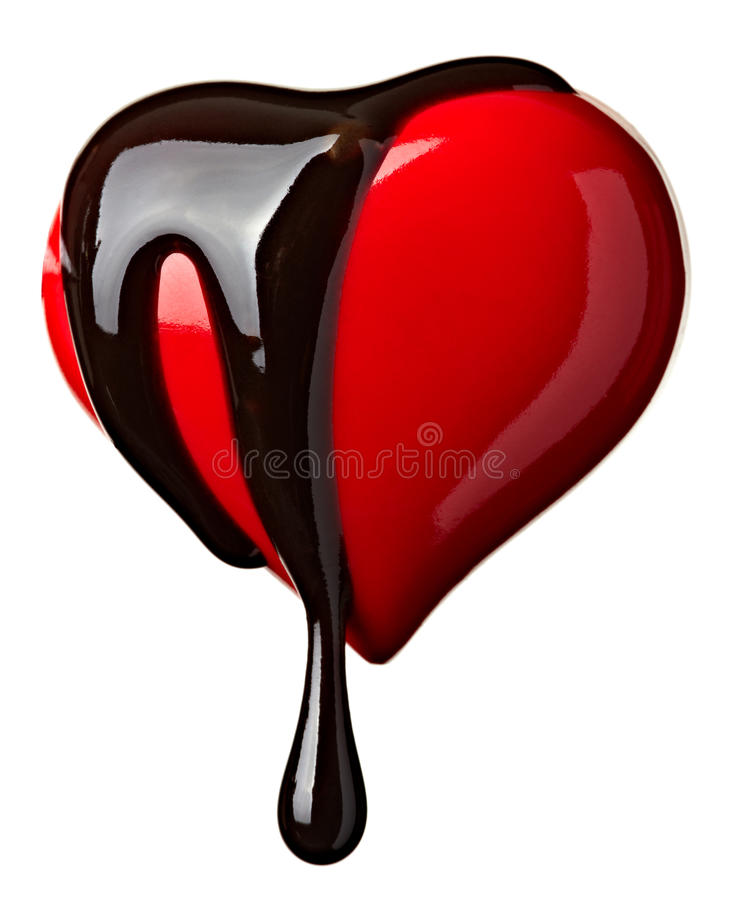 Chocolate syrup leaking on heart shape. Close up chocolate syrup leaking over heart shape symbol on white background with clipping path stock photo