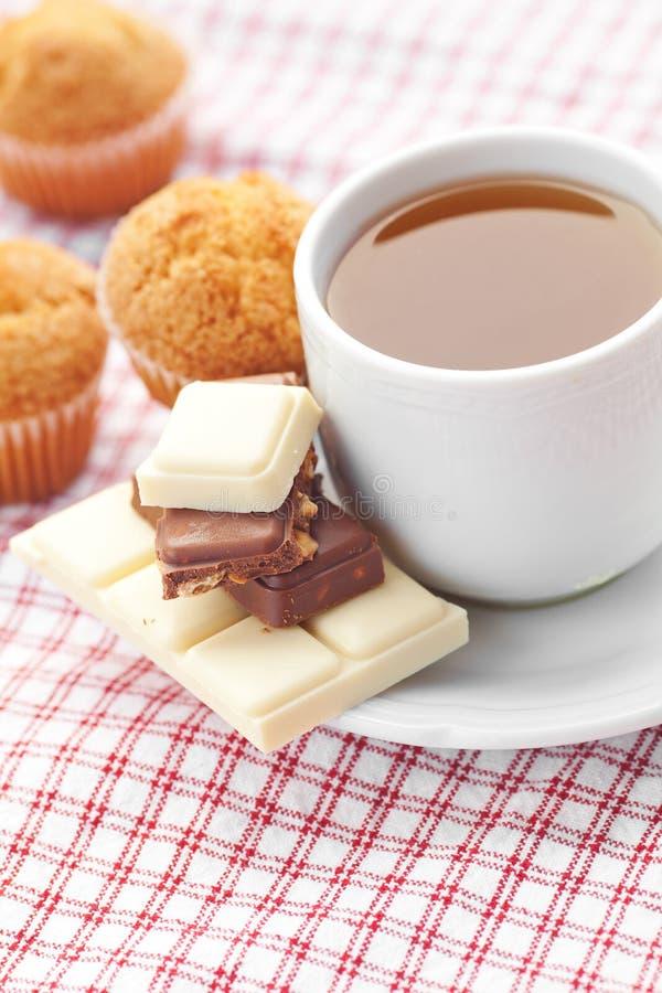 Chocolate,tea and muffin on plaid fabric