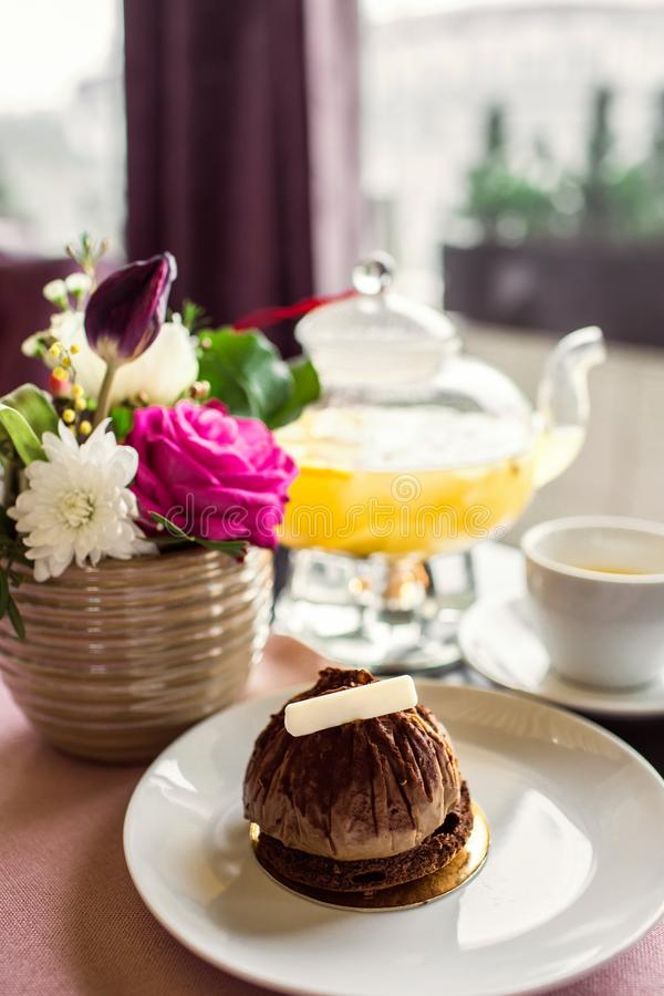Free Chocolate Truffle Cake Dessert With White Chocolate. Pineapple Tea With A Transparent Glass Teapot. Citrus Vitamin Tea And A Beaut Royalty Free Stock Image - 113148406