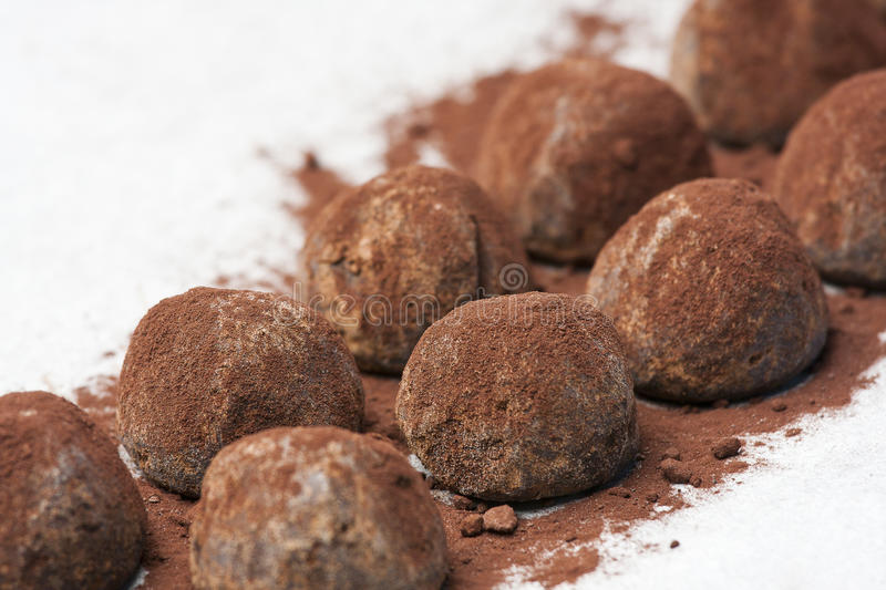 Chocolate truffle candy. Isolated on white background stock images
