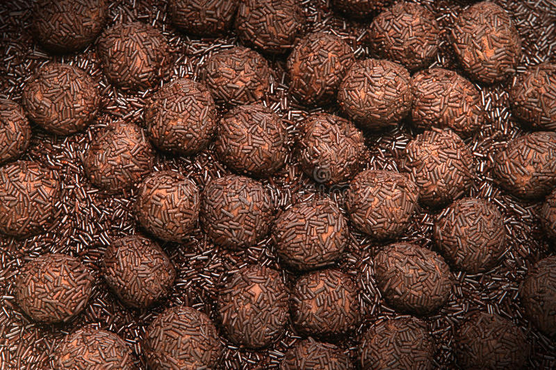 Chocolate truffles. Group of brown chocolate truffles on chocolate bed royalty free stock photos