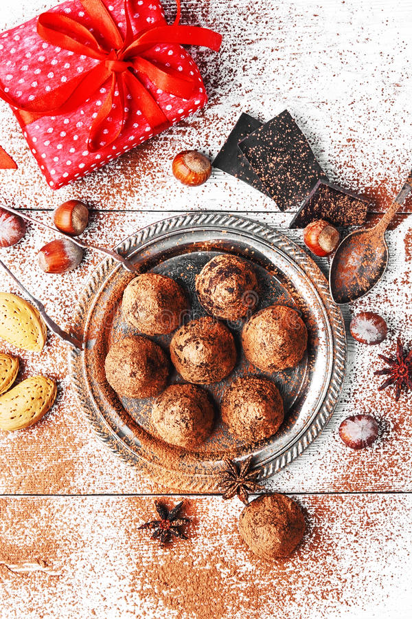 Chocolate truffles balls. Chocolate truffles with cocoa and nuts and red box with gift stock images