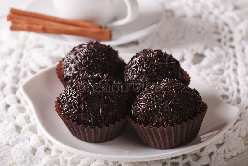 Chocolate truffles Brigadeiro on a plate close-up. horizontal. Delicious chocolate truffles Brigadeiro on a plate close-up. horizontal stock photography