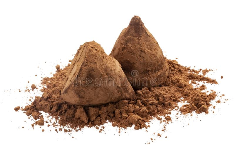 Chocolate truffles on cocoa powder isolated on white background royalty free stock photography
