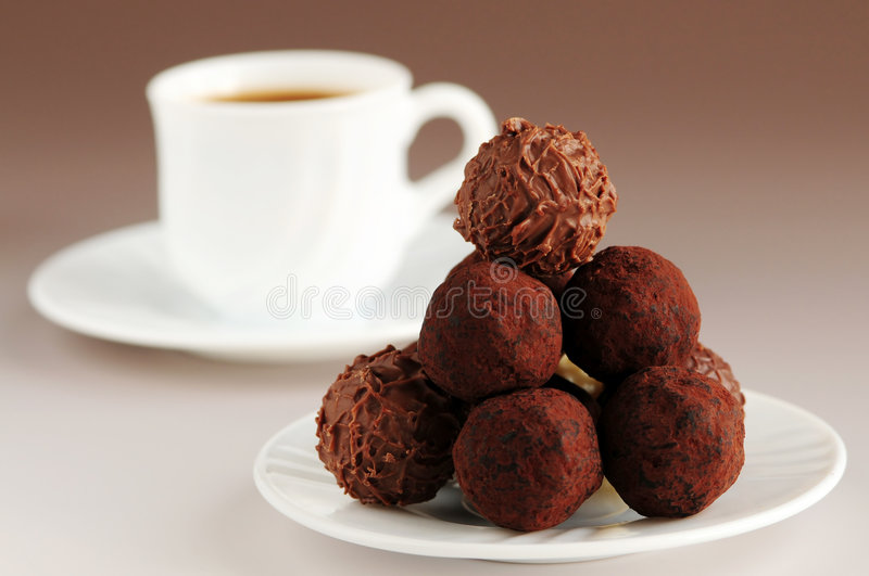 Chocolate truffles and coffee royalty free stock photography
