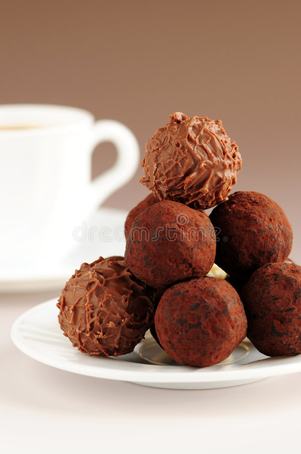 Chocolate truffles and coffee stock photo