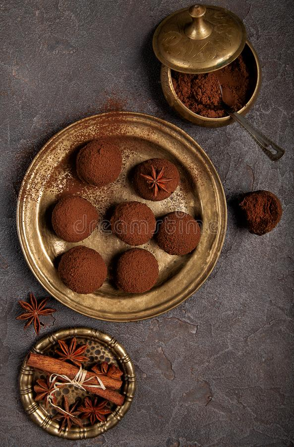Chocolate truffles in a copper plate royalty free stock photography