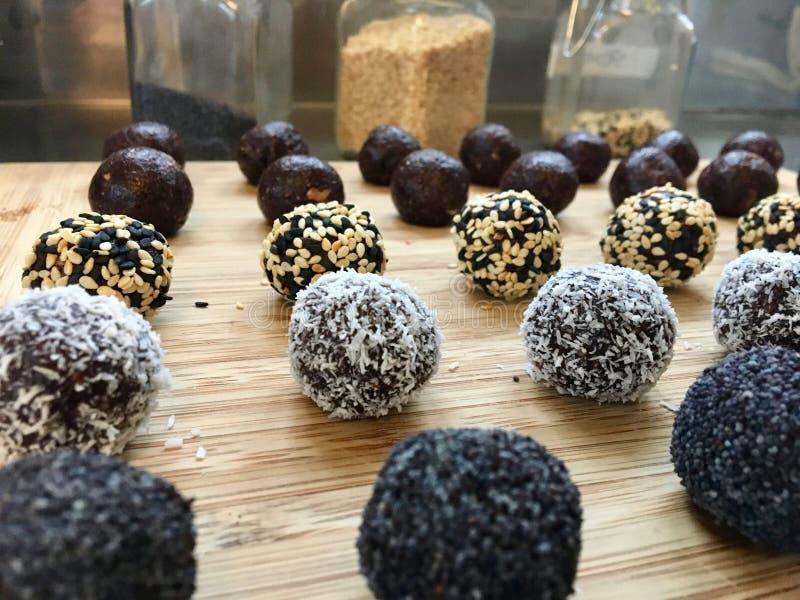 Chocolate truffles and energies balls. Vegan, gluten free, healthy ingredients stock photos