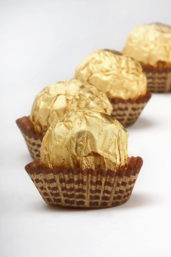 Chocolate truffles in foil wrap royalty free stock photo