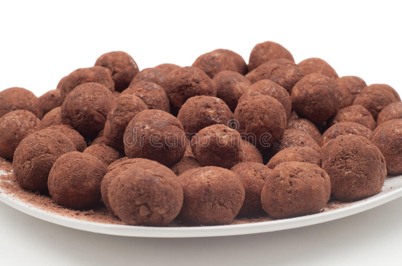 Chocolate truffles. On the plate on light background stock photos