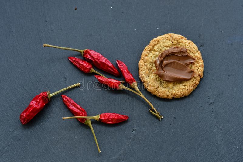 Cookies and red hot chili peppers royalty free stock photo