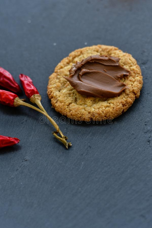 Cookies and red hot chili peppers royalty free stock images