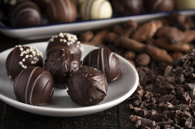 Chocolate Truffles on a Rustic Wooden Table. A Moody Image of Chocolate Truffles on a Rustic Wooden Table royalty free stock photo