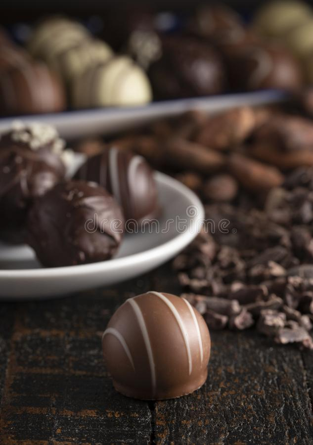 Chocolate Truffles on a Rustic Wooden Table. A Moody Image of Chocolate Truffles on a Rustic Wooden Table royalty free stock image