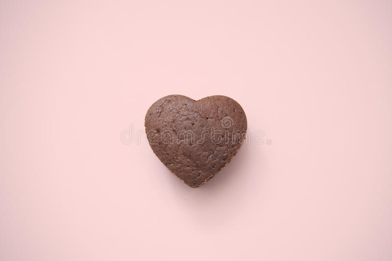 Chocolate Valentine Cake on pink background royalty free stock images