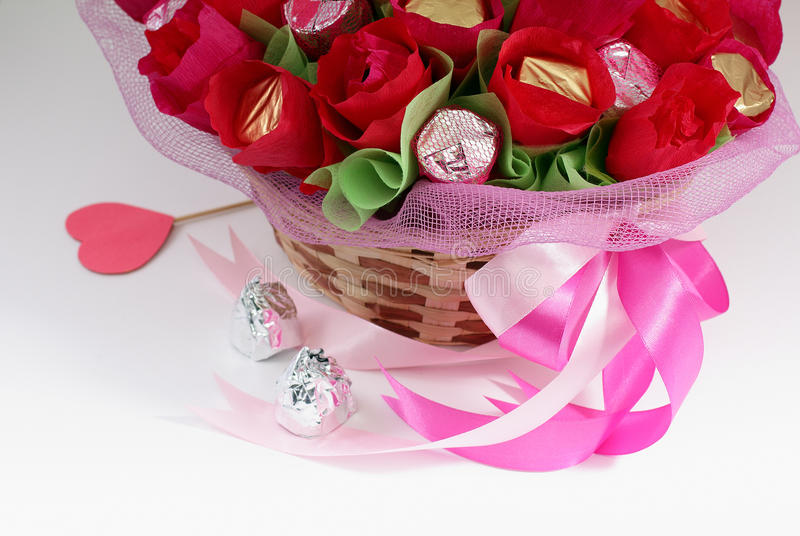 Chocolate Valentine's Day. Bunch of delicious chocolates that look like flowers in a basket royalty free stock photo
