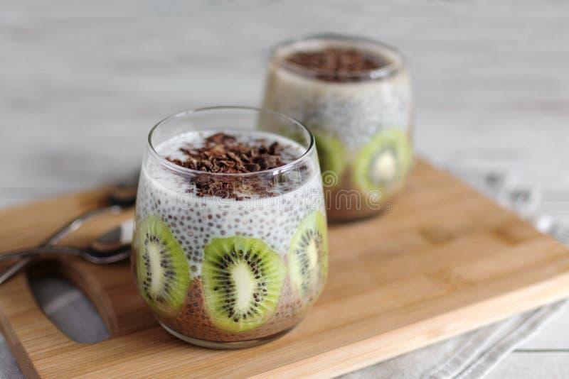 Chocolate and vanilla chia seed pudding with kiwi stock photos