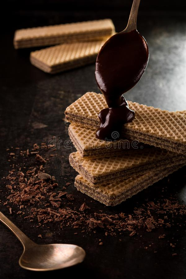Chocolate wafers covered by a melted chocolate stock photos