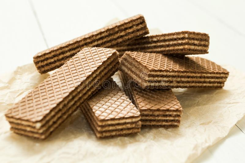 Chocolate wafers on a white wooden table royalty free stock photography