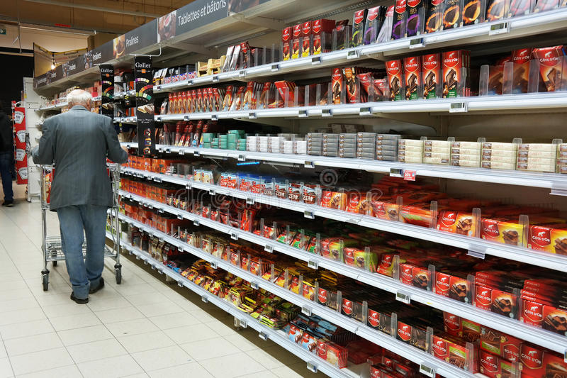 Chocolate. WALLONIA, BELGIUM - OCTOBER 2014: Aisle with a variety of chocolate products in a Carrefour Hypermarket stock photos