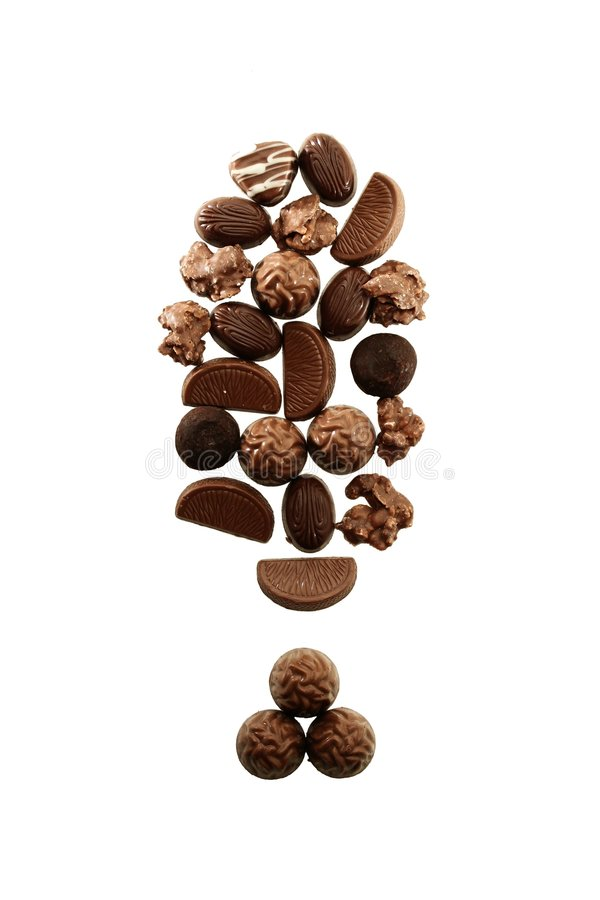 Chocolate warning. An exclamation mark compiled of chocolate pralines, indicating warning against unhealthy diet royalty free stock image