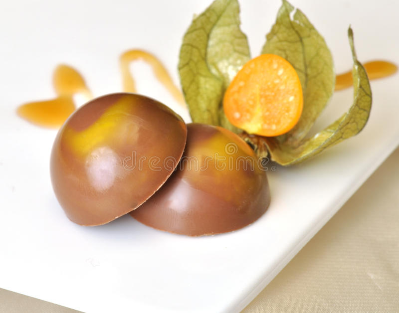 Chocolates. With a wild fruit was a awesome combination stock images