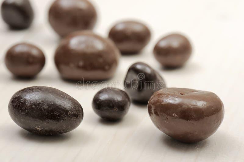 Chocolates. Bon bon, on wooden table royalty free stock photos