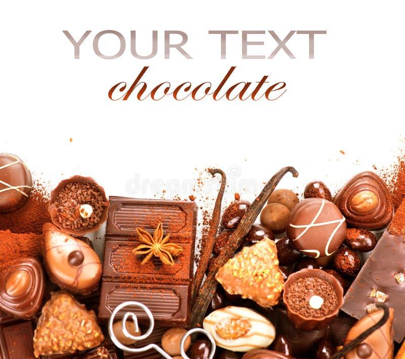 Chocolates border isolated on white stock photography