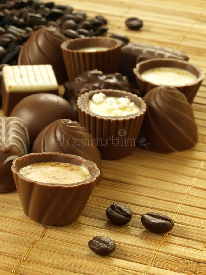 Chocolates with coffee, closeup royalty free stock photos