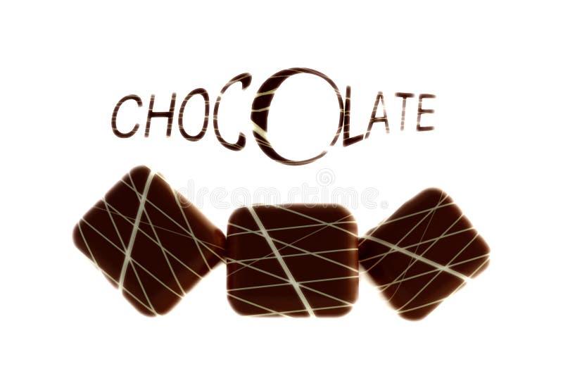 Chocolates com texto imagem de stock royalty free