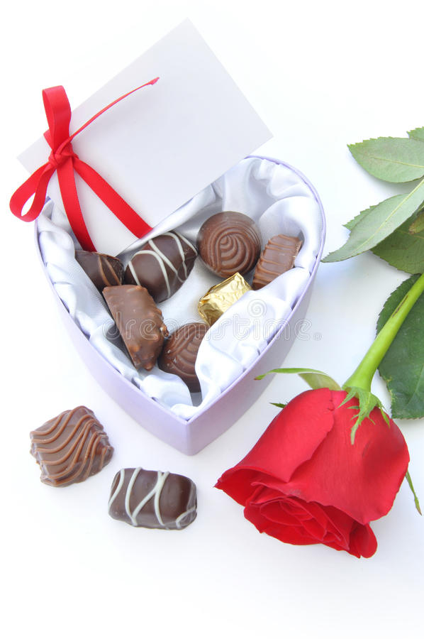 Chocolates and red rose royalty free stock photography