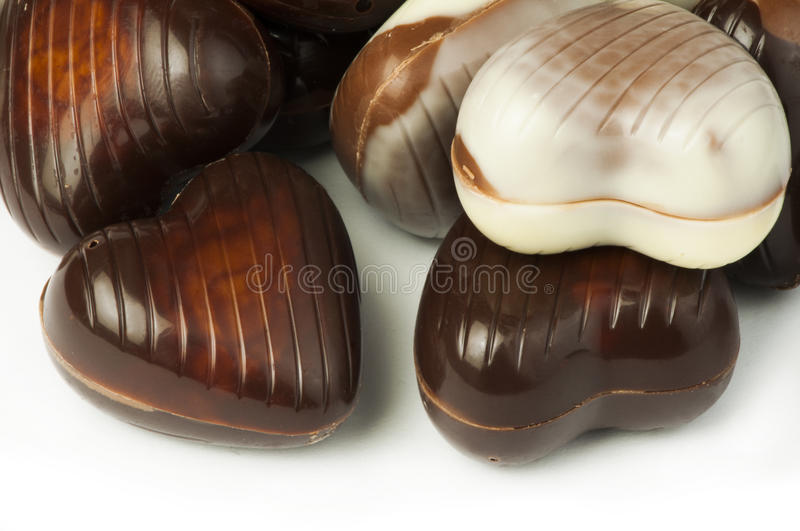 Chocolates in the shape of hearts. White isolated stock photography