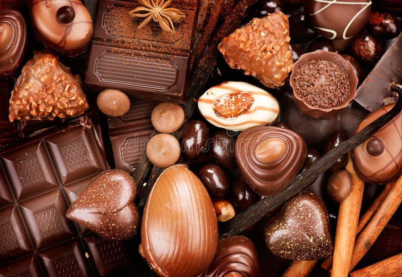 Chocolates sweets background. Chocolates background. Praline chocolate sweets royalty free stock images
