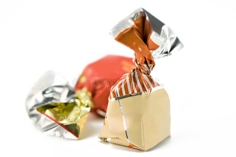 Chocolates on a white background. Chocolates in bright packing on a white background stock images