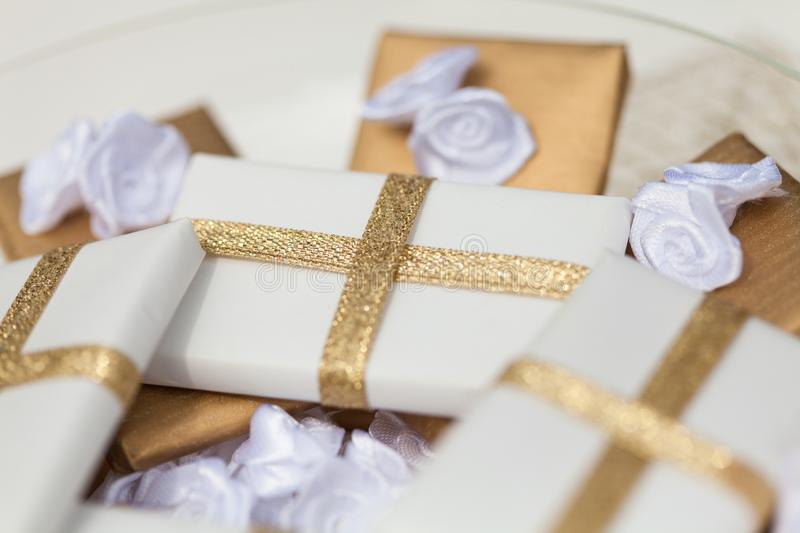 Chocolates wrapped in white and golden paper royalty free stock photo