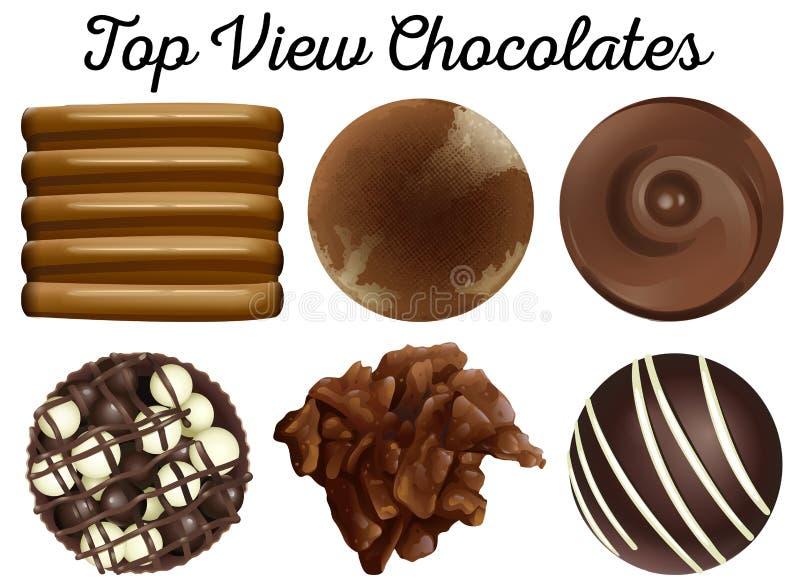 Chocolats de vue supérieure dans différentes formes illustration stock