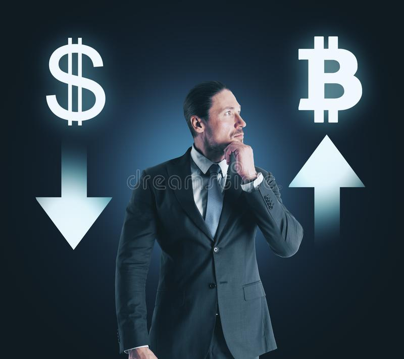 Choice, cryptocurrency and finance concept. Portrait of attractive thoughtful young businessman with digital money signs on dark background stock photo