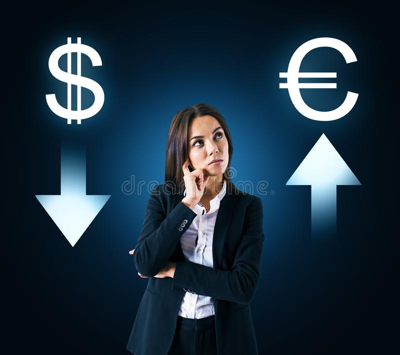 Choice, cryptocurrency and stats concept. Portrait of attractive thoughtful young businesswoman with digital money signs on dark background royalty free stock photos