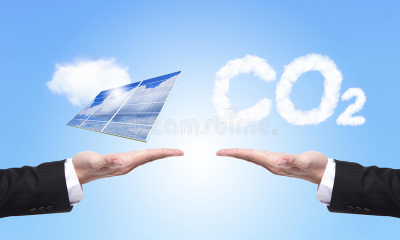 Choice solar panel or co2. Eco concept - choice solar panel or co2, Business man hold Alternative Energy (solar cell ) with blue sky and cloud background stock image