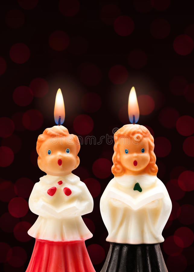 Choir Boy and Girl Candles. Isolated on a dark background royalty free stock image