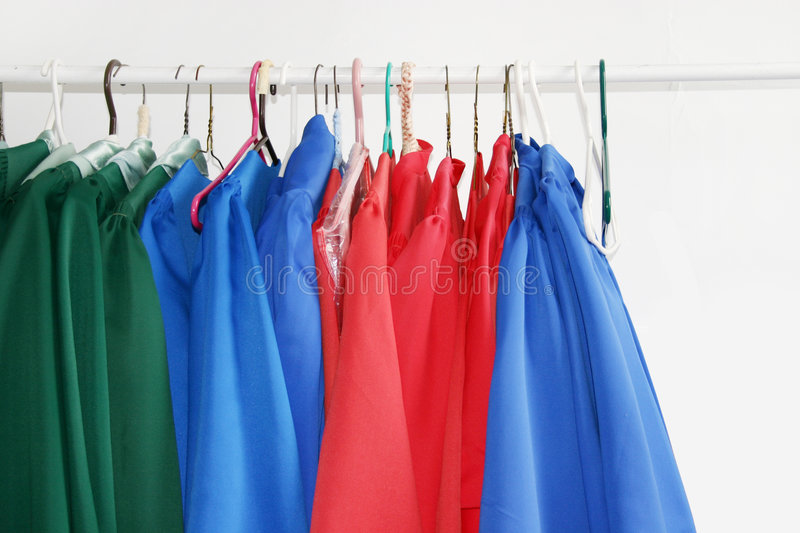 Choir Robes. Assorted colors of church choir robes hanging royalty free stock photo