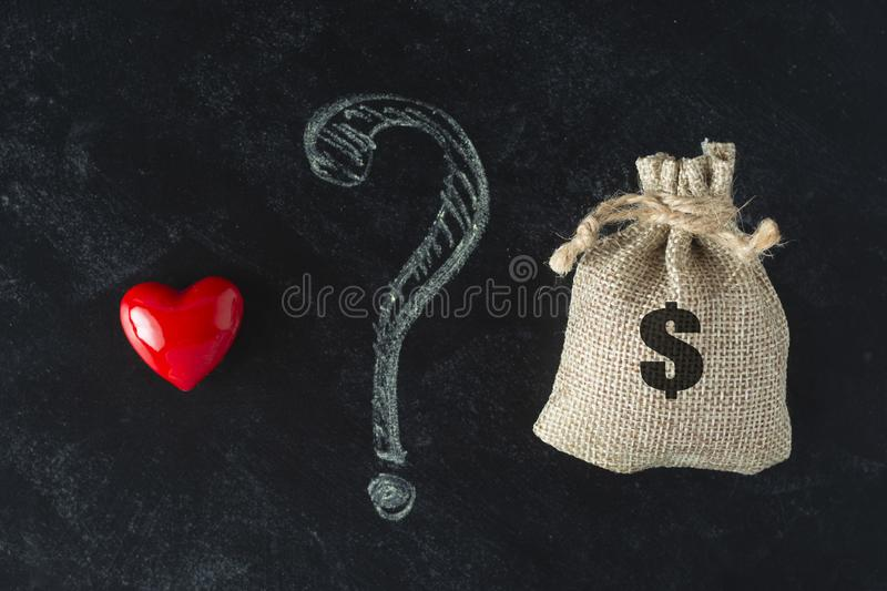 Choise concept. Money or love concept. Family or career choice. Life balance royalty free stock image