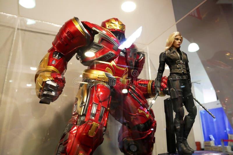 Choisi s'est concentré sur le nombre d'actions de caractère d'IRON MAN des bandes dessinées et des films d'Iron Man de merveille photographie stock